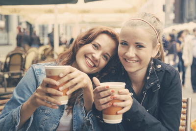 Two women smiling while having a coffee at Portland, OR.